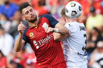 Tomi Juric, left, and Scott Jamieson, right, in action in Adelaide.