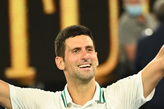 Novak Djokovic celebrates his ninth Australian Open title.