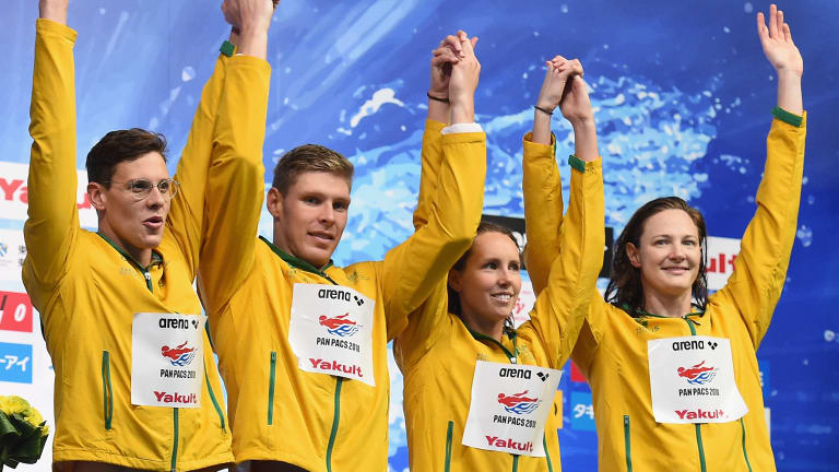 Strong start: Mitch Larkin (left) celebrates during the medal presentation of the 4x100m Medley Relay Final.