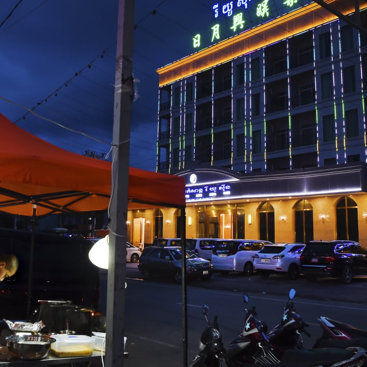 A Chinese food vendor cooks outside a Chinese casino in Sihanoukville.