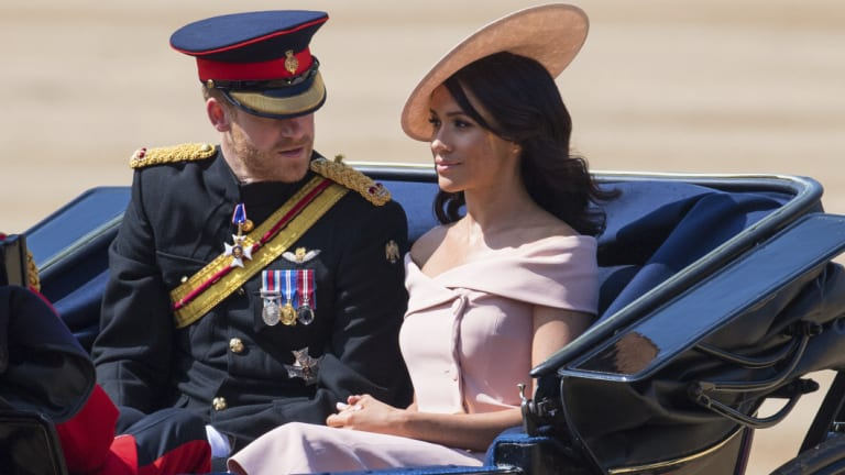 Prince Harry and Meghan, the Duchess of Sussex, ride in a carriage during the Trooping the Colours ceremony as the Queen celebrates her official birthday in London.