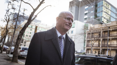 Former Victoria Police superintendent Brett Guerin leaves the Supreme Court in August.