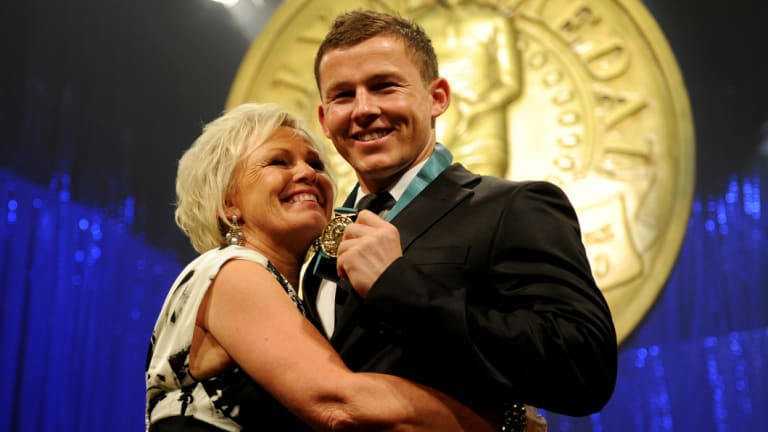 England-bound: Toss Carney with mother Leanne after his Dally M medal win in 2010.