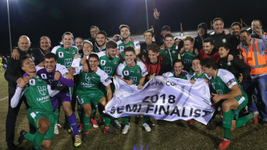 Coach John Anastasiadis (far left) and his Bentleigh Greens celebrate making the semis.