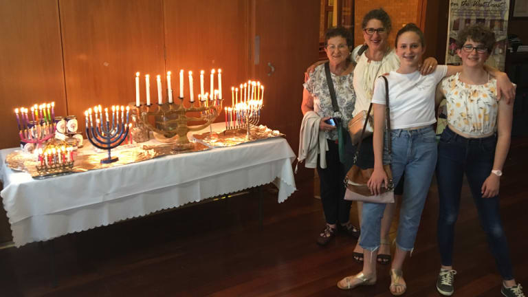 Sara Hall's family brought their wooden candelabrum (the biggest) to usher in the final night of Hanukkah on Sunday.