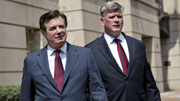 Paul Manafort exits the District Courthouse after a motion hearing in Virginia with his lawyer this month.