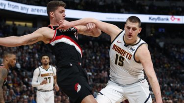 Nikola Jokic, pushes off Meyers Leonard.