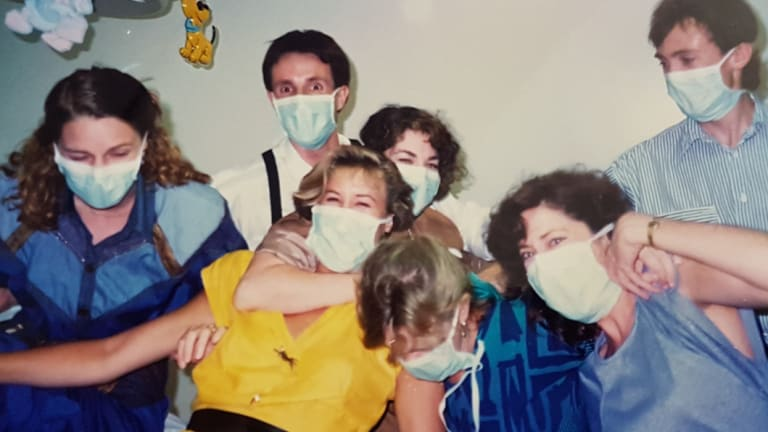 Young doctors Steve Robson, in the white shirt, and Kate Tree, far left, at a party at Rockhampton Base Hospital in 1988.