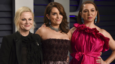 Amy Poehler, from left, Tina Fey and Maya Rudolph at the Vanity Fair Oscar Party.