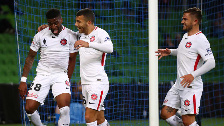 Rolieny Bonevacia of the Wanderers celebrates his goal with Marcelo Carrusca and Josh Risdon at AAMI Park.