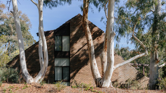 An end-row house on the Wybalena Grove community in the Canberra suburb of Cook.