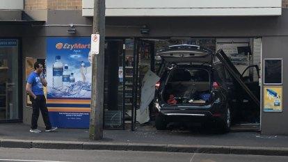 Car ploughs inside inner Sydney shop