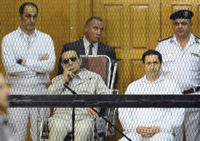 Egyptian President Hosni Mubarak, seated centre left, and his two sons, Gamal Mubarak, left, and Alaa Mubarak attend a hearing in a courtroom in Cairo, Egypt, 2013.