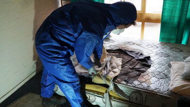 Melbourne Forensic Cleaners Josh Marsden removes biohazard material.
