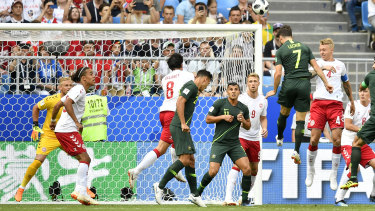 Head and shoulders above: Mathew Leckie beats the Danish defence to get a clear header towards goal, as Australia took the game to the world no.12 side.