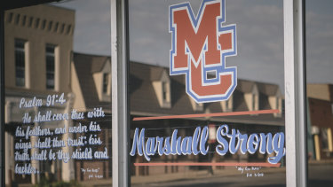 A psalm and a message of solidarity on a downtown shop window in the wake of the Marshall County High School shooting.