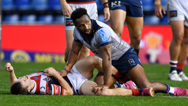 Sydney Roosters halfback Sam Walker after getting hit by Melbourne Storm centre Justin Olam.