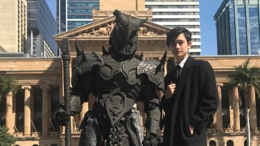 Designer Max Milann (right) and costume maker Romeo Lazarus take to the streets of Brisbane with one of the  seven deadly sins.