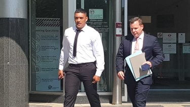 Brisbane Broncos player Teui Robati leaves court with his lawyer Dave Garratt.