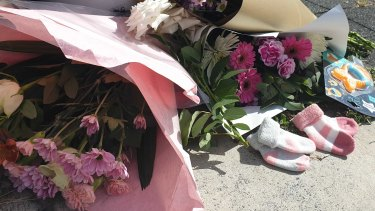 Tributes left for the couple killed at Alexandra Hills.
