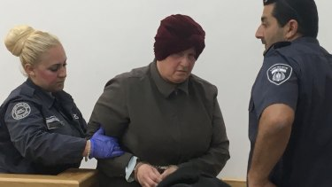 Malka Leifer being forcefully led away after she left court early feeling unwell on May 2, 2018.