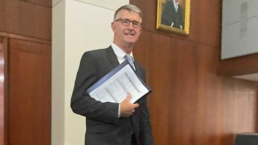 Deputy LNP Leader and Shadow Treasurer Tim Mander delivering the LNP's election costings at Queensland Parliament.
