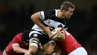 Angus Cottrell of the Barbarians is tackled by Adam Beard and Ollie Griffiths of Wales in Cardiff.