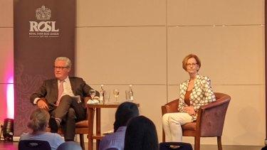 Former Foreign Minister Alexander Downer and former Prime Minister Julia Gillard in London.