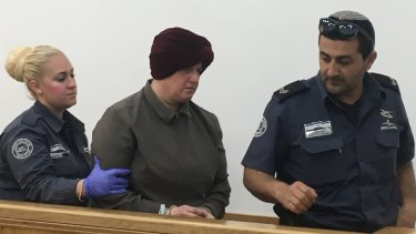 Malka Leifer is led from the court.