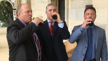 KAP MPs Shane Knuth, Robbie Katter and Nick Dametto drink to the expected passing of the Rural Hotels Concessions Bill.