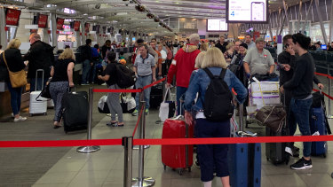 Sydney Airport is experiencing significant delays and cancellations to flights as winds and rain take hold of the city.