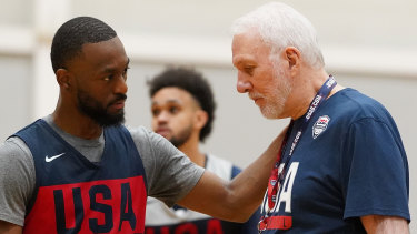 Kemba Walker talks to Team USA coach Gregg Popovich during a training session in Melbourne.