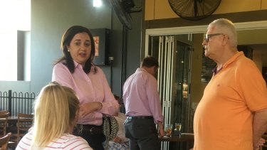 Premier Annastacia Palaszczuk speaking to locals at a fish and chips shop on the Gold Coast.
