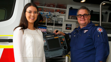 CPR and a public-access defibrillator used by off-duty nurse Grace Jones, seen here with  ICU paramedic Brian Parcell, saved Greg Page's life.