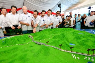 Then Malaysian Prime Minster Najib Razak, third from left, looks at modals of ECRL (East Coast Rail Link) during the project launching in Kuantan, east cost of peninsula Malaysia in 2018.