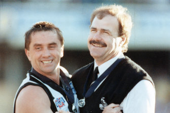 Matthews with Collingwood premiership captain Tony Shaw after their grand final win in 1990.