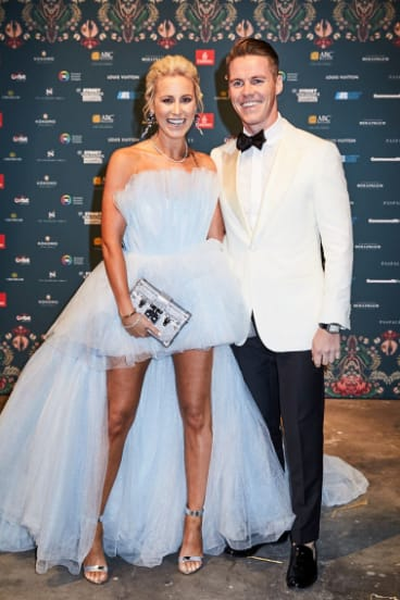 Roxy Jacenko, wearing her famous 'mullet dress' with her husband, Oliver Curtis, at the exclusive Gold Dinner this year.