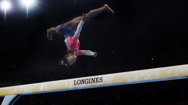 Superstar: Biles performs on the balance beam during the women's team finals on day five.
