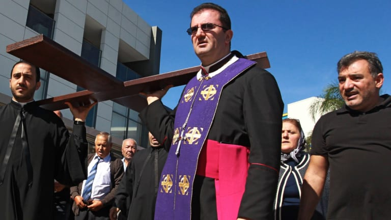 Bishop Tarabay leads a procession at the Good Friday Mass of Our Lady of Lebanon Church, Harris Park, in 2014.