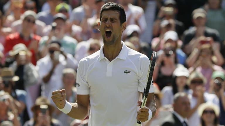 Novak Djokovic of Serbia celebrates defeating Kei Nishikori of Japan.