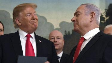 President Donald Trump smiles at Israeli Prime Minister Benjamin Netanyahu last month.