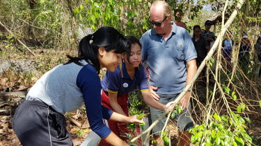 ROLE Foundation founder and CEO Mike O'Leary speaks to Bali WISE students about the importance of planting grass and how to keep soil healthy during a lesson in Bali.
