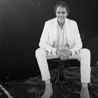 Tim wears Ian Nessick suit and shirt, Marc Newson x R.M. Williams boots, Uniqlo socks.