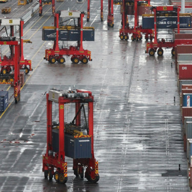 An automated terminal at Port Botany, where machines load vast volumes of goods onto ships without touching human hands.