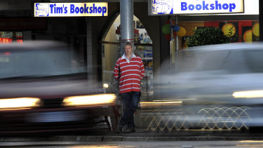 Tim outside the store in 2010. He says retirement will give him more time to play in his rock/pop cover band.