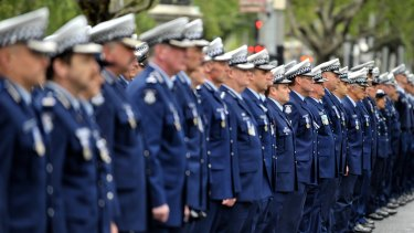 Police marching to remember fallen comrades in 2011.