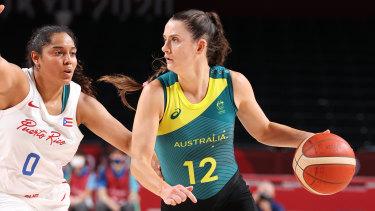 Tess Lavey #12 of Team Australia drives to the basket against Jennifer O'Neill.