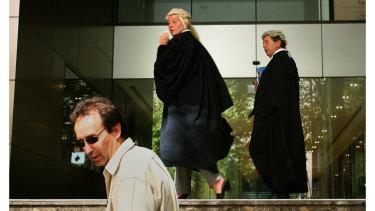 Nicola Gobbo enters court with Con Heliotis, QC in 2006.