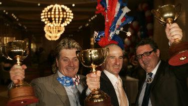 Tony Santic [owner], Glenn Boss [jockey] and Lee Freedman [trainer] celebrate  the third Melbourne cup win.