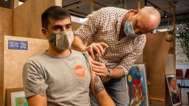 Joe Laney, 32, receives the AstraZeneca vaccine.